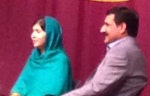 Malala Yousafazai and her father Ziauddin in Boston last Saturday.